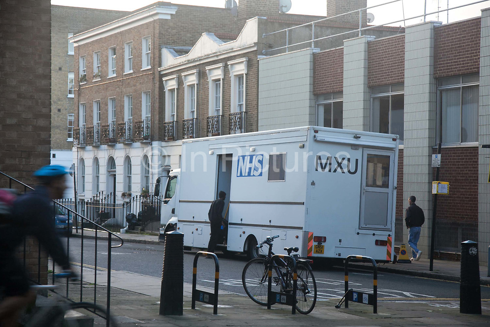 The NHS MXU van is parked up outside St Mungo's hostel near King's Cross. <br /> The rates of tuberculosis in London are higher than any other Western European capital and is a major health problem. Tuberculosis is highly contagious, it is treatable, but in the event of no treatment it is often deadly. The MXU, the Mobile X-ray Unit, is a facility run by the NHS. The MXU is a Tuberculosis screening service on wheels where people can have their chest x-rayed and within minutes be either cleared of TB - or in case of any TB symptoms showing up on the X-rays, be referred to a hospital for further tests and possible treatment. The MXU is aimed at hard to reach groups like homeless people, drug or alcohol abuser and prisoners. The van is the only one in the UK and operates around London where it visits hostels, prisons and community centres where groups of hard to reach clients usually gather. On the van is a team of nurses, radiographers, social and outreach workers and expert technicians. The MXU van is a part of the NHS department Find and Treat.