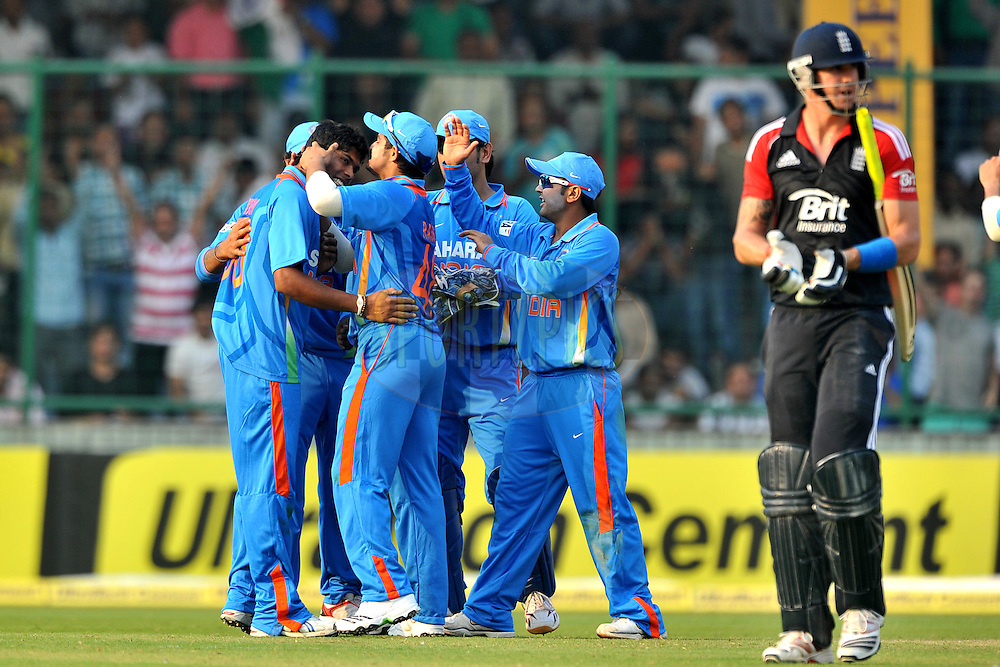 Umesh Yadav of India celebrates the wicket of Kevin Pietersen of England during the 2nd One Day International ( ODI ) match between India and England held at the The Feroz Shah Kotla Stadium, Delhi on the 17th October 2011..Photo by Pal Pillai/BCCI/SPORTZPICS