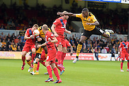 Aaron Hayden of Newport county ® jumps but misses the ball. Skybet football league two match, Newport county v York city at Rodney Parade in Newport, South Wales on Saturday 5th Sept 2015.  pic by Andrew Orchard, Andrew Orchard sports photography.