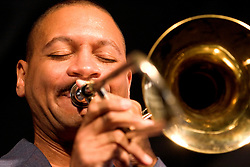 April 23rd, 2005. New Orleans, Louisiana,  USA. <br /> New Orleans Jazz and Heritage Festival. JazzFest.<br /> Delfeayo Marsalis, son of Legendary Jazz pianist Ellis Marsalis plays the Jazz tent.<br /> Ellis Marsalis passed away April 1st 2020 of complications associated with Coronavirus - COVID-19.<br /> Photo ©; Charlie Varley/varleypix.com
