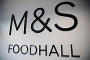 Sign for department store and supermarket chain Marks and Spencer in Birmingham, United Kingdom. Marks & Spencer Group plc, also known as M&S, is a major British multinational retailer and specialises in the selling of clothing, home products and luxury food products.
