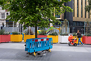 An urban lanscape of old buildings and trees, part of a regenerated pedestrian area between Charing Cross Road and New Oxford Street in the West End, on 9th July 2021, in London, England.