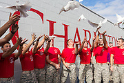 Citadel Military college cadets release doves into the air to inaugurate the Charleston Strong mural during ceremonies October 21, 2015 in Charleston, South Carolina. The wall is to commemorate the mass shooting at the historic Mother Emanuel African Methodist Episcopal Church last June.