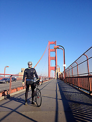 © Licensed to London News Pictures. 31/10/2013. San Francisco California, USA. James Ketchell world cycle/ global triathlon: James stands proudly on the Golden Gate Bridge. The previous parts of this incredible and unique series were an Atlantic solo row in 2010 and summiting Everest in 2011.Photo credit : Ian Homer/LNP