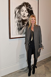 KATE MOSS at a private view of photographs by David Bailey entitled 'Bailey's Stardust' at the National Portrait Gallery, St.Martin's Place, London on 3rd February 2014.