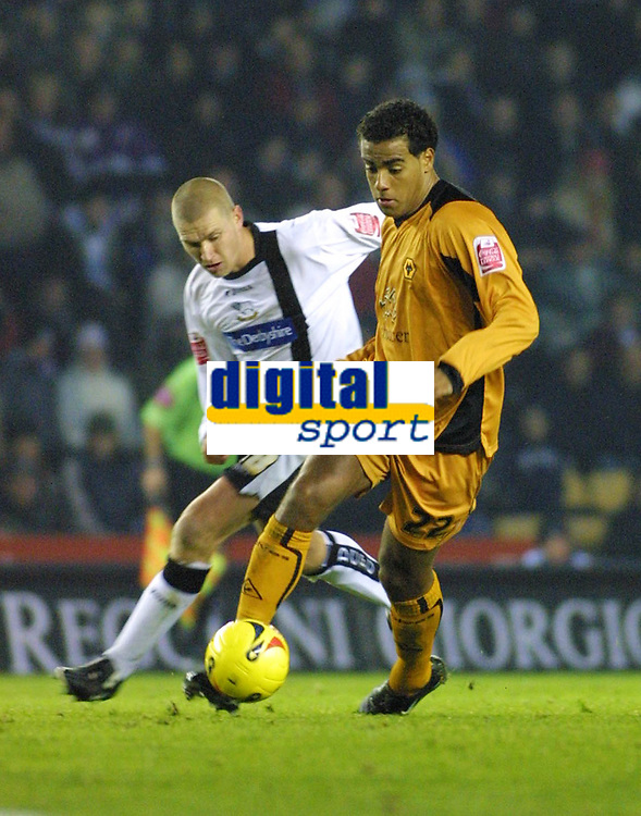 Photo: Dave Linney.<br />Derby County v Wolverhampton Wanderers. Coca Cola Championship. 18/11/2005.Tom Huddlestone on the attack for Wolves ahead of   Morton Bisgaard(Derby)