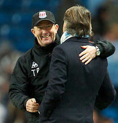 MANCHESTER, ENGLAND - Sunday, February 13, 2010: Manchester City's manager Roberto Mancini and Stoke City's manager Tony Pulis during the FA Cup 5th Round match at the City of Manchester Stadium. (Photo by David Rawcliffe/Propaganda)  MANCHESTER, ENGLAND - Sunday, February 13, 2010: Manchester City xxxx and Stoke City's xxxx during the FA Cup 5th Round match at the City of Manchester Stadium. (Photo by David Rawcliffe/Propaganda)