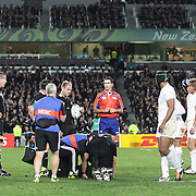 All Blacks captain Richie McCaw is treated near the end of the game holding play up during the New Zealand V France Final at the IRB Rugby World Cup tournament, Eden Park, Auckland, New Zealand. 23rd October 2011. Photo Tim Clayton...