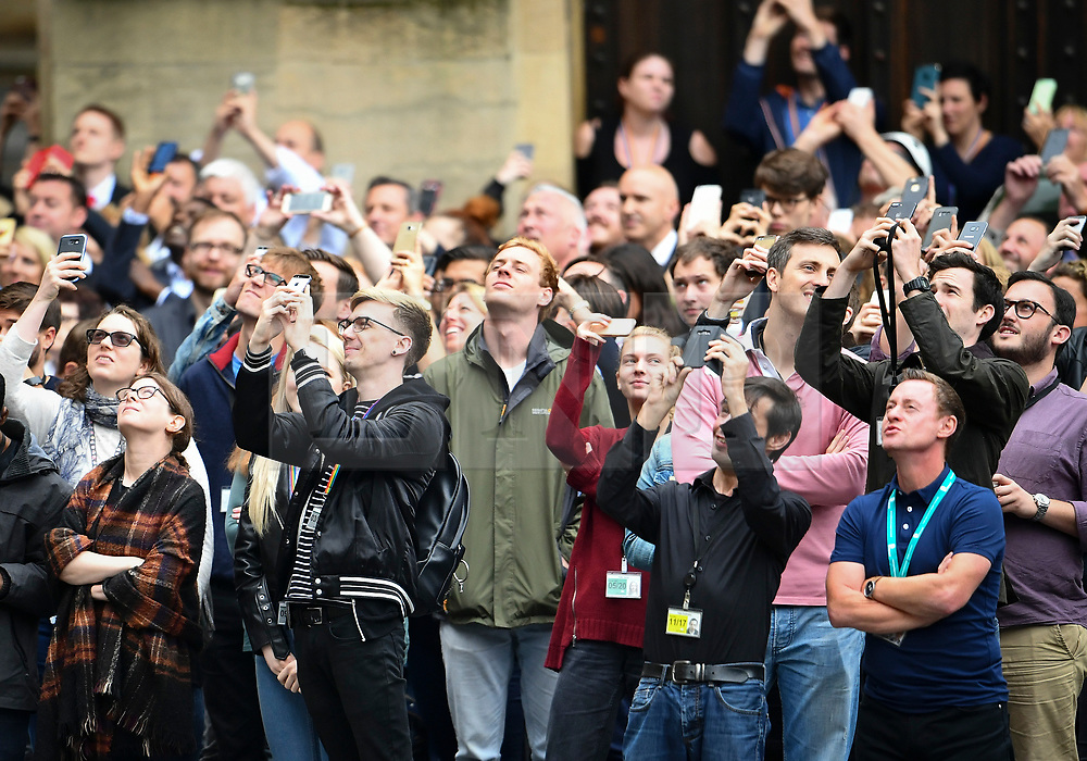 © Licensed to London News Pictures. 21/08/2017. London, UK. A group of people gather in the grounds of The Houses of Parliament Parliament at mid day as Big Ben chimes for the last time ahead of repair works. The Great Bell, also known as Big Ben, is expected to be silent for up to four years as renovation work is carried out on the surrounding Elizabeth Clock Tower. The worlds most famous clock has sounded on the hour for 157 years and last fell silent for maintenance work in 2007. Photo credit: Ben Cawthra/LNP