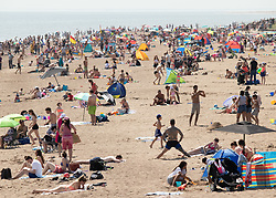 © Licensed to London News Pictures. 25/07/2019. Skegness, Lincolnshire, UK. Skegness seaside resort swelters under the summer heat. A packed beach at Skegness. Photo credit: Dave Warren/LNP