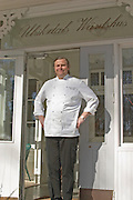 The owner and chef of the Ulriksdals Wärdshus restaurant Gunnar Ström on the porch outside the restaurant. Strom Ulriksdal Ulriksdals Wärdshus Värdshus Wardshus Vardshus Restaurant, Stockholm, Sweden, Sverige, Europe