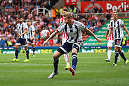 James McClean of West Bromwich Albion crosses the ball. Barclays Premier League match, Stoke city v West Bromwich Albion at the Britannia stadium in Stoke on Trent, Staffs on Saturday 29th August 2015.<br /> pic by Chris Stading, Andrew Orchard sports photography.