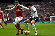 Son Heung-min of Tottenham Hotspur (R) in action with Hector BellerÌn of Arsenal (L). Premier league match, Tottenham Hotspur v Arsenal at Wembley Stadium in London on Saturday 10th February 2018.<br /> pic by Steffan Bowen, Andrew Orchard sports photography.
