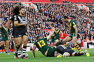 Australia celebrate Trent Merrin's try during the Ladbrokes Four Nations match between Australia and New Zealand at Anfield, Liverpool, England on 20 November 2016. Photo by Craig Galloway.