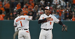 August 28, 2017 - Baltimore, MD, USA - Orioles' Jonathan Schoop, right, celebrates with Tim Beckham after defeating the Mariners 7-6 Monday, Aug. 28, 2017 at Oriole Park at Camden Yards in Baltimore, Md. (Credit Image: © Kenneth K. Lam/TNS via ZUMA Wire)
