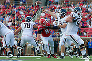 DALLAS, TX - NOVEMBER 16: Casey Cochran #12 of the Connecticut Huskies drops back to pass against the SMU Mustangs on November 16, 2013 at Gerald J. Ford Stadium in Dallas, Texas.  (Photo by Cooper Neill/Getty Images) *** Local Caption *** Casey Cochran