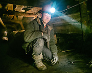 Life in the illegal coal mines of Nailakh on the edge of Ulan Bator. Burning fossil fuels is the primary source of both climate-warming emissions and health-damaging air pollution. Miners are particularly exposed to the dangerous fine Pm2.5 particles that enters the bloodstream.<br /> Mongolia