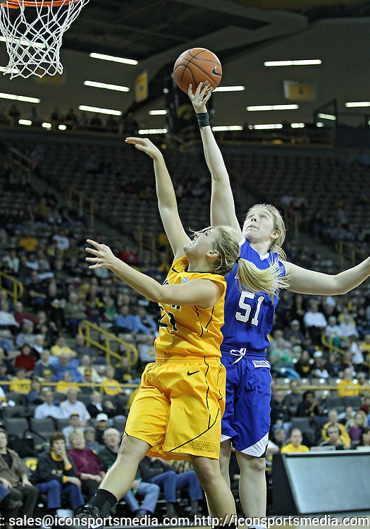 December 20, 2011: Iowa Hawkeyes guard Melissa Dixon (21) and Drake Bulldogs forward Cara Lutes (51) battle for a rebound during the NCAA women's basketball game between the Drake Bulldogs and the Iowa Hawkeyes at Carver-Hawkeye Arena in Iowa City, Iowa on Tuesday, December 20, 2011. Iowa defeated Drake 71-46.