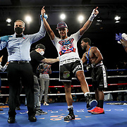 Ofacio Falcon celebrates a victory over Jonathan Gray during a One For All Promotions boxing event at the Caribe Royale Orlando Events Center on Saturday, February 20, 2021 in Orlando, Florida. (Alex Menendez via AP)