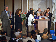 Civil rights heroine Rosa Parks stands at the podium surrounded by President Bill Clinton, US House Speaker Dennis Hastert and her attendant Elaine Steele after being awarded the Congressional Gold Medal June 15, 1999 in Washington, DC. Parks was awarded the Congressional Gold Medal for her act of defiance that started a bus boycott that became a landmark in the civil rights struggle of the 1950s and 1960s.