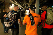 Johny Hendricks leaves the American Airlines center after hours of interviews with the UFC Welterweight Championship belt and a Bud Light at UFC 171 in Dallas, Texas on March 15, 2014.