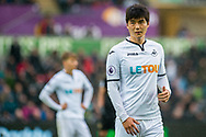 Ki Sung-Yueng of Swansea City looks on. Premier league match, Swansea city v Leicester city at the Liberty Stadium in Swansea, South Wales on Saturday 21st October 2017.<br /> pic by Aled Llywelyn, Andrew Orchard sports photography.