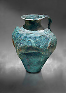 Minoan bronze jug decorated with spirals and arches, Akrotiri, Thira (Santorini) National Archaeological Museum Athens. 17th-16th cent BC. .<br /> <br /> If you prefer to buy from our ALAMY PHOTO LIBRARY  Collection visit : https://www.alamy.com/portfolio/paul-williams-funkystock/minoan-art-artefacts.html . Type -   Athens    - into the LOWER SEARCH WITHIN GALLERY box. Refine search by adding background colour, place, museum etc<br /> <br /> Visit our MINOAN ART PHOTO COLLECTIONS for more photos to download  as wall art prints https://funkystock.photoshelter.com/gallery-collection/Ancient-Minoans-Art-Artefacts-Antiquities-Historic-Places-Pictures-Images-of/C0000ricT2SU_M9w
