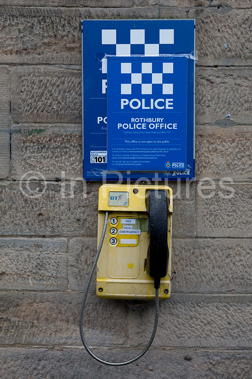 A detail of a Northumberland emergency and non-emergency phone, outside a rural police station, on 25th September 2017, in Rothbury, Northumberland, England.