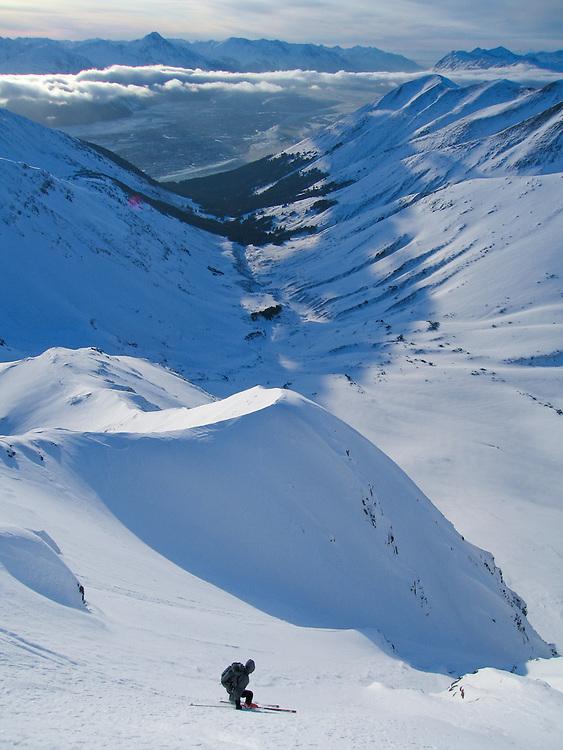 A skier descends a peak in the Chugach Mountains, near Girdwood, Alaska