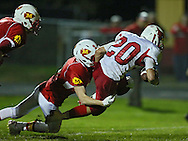 Maquoketa's Joshua Kirk (20) scores a touchdown as he his brought down by Marion's Ben Buckley (9) during the first half of the game between Maquoketa and Marion at Thomas Park Field in Marion on Friday, September 21, 2012.