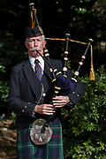 Bagpiper, Frank Hunter plays bagpipes during the Remembrance Sunday ceremony at the Hodogaya, Commonwealth War Graves Cemetery in Hodogaya, Yokohama, Kanagawa, Japan. Sunday November 12th 2017. The Hodagaya Cemetery holds the remains of more than 1500 servicemen and women, from the Commonwealth but also from Holland and the United States, who died as prisoners of war or during the Allied occupation of Japan. Each year officials from the British and Commonwealth embassies, the British Legion and the British Chamber of Commerce honour the dead at a ceremony in this beautiful cemetery.
