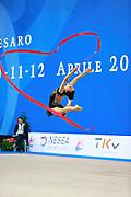 Alevrogianni Korina during qualifying at ribbon in Pesaro World Cup 11 April 2015. Korina  was born on 5 June,1997 in Athens. She is a Greek individual rhythmic gymnast.