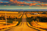 Country road at sunset <br /> Grande Prairie <br /> Alberta<br /> Canada