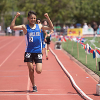 Navajo Pine Warrior Ryan Kee flexes his muscles as he finishes the 3200 meter run in first place at the NMAA 2A track and field state finals in Albuquerque Friday.
