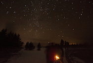 Night hikers among the steam and stars, Yellowstone National Park