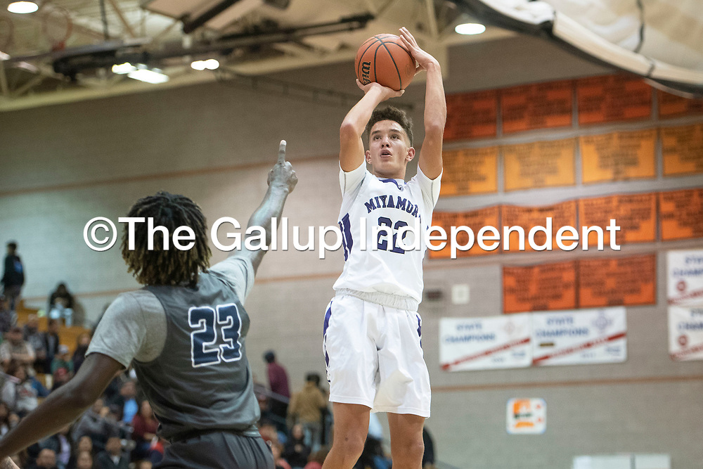 Miyamura's Cael Stewart (22) takes a shot as Spring Valley's James Webster (23) defends at the Gallup Invitational boys basketball tournament Thursday, Jan 2 at Gallup High School.