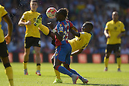 Idrissa Gueye of Aston Villa attempts to kick the ball over Pape N'Diaye Souare of Crystal Palace who gets the ball in his face. Barclays Premier league match, Crystal Palace v Aston Villa at Selhurst Park in London on Saturday 22nd August 2015.<br /> pic by John Patrick Fletcher, Andrew Orchard sports photography.