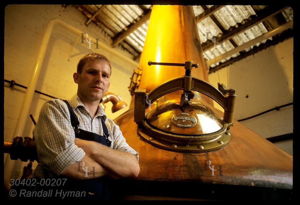 Stillman Ian Renwick poses beside the spirit still at Glenturret, Sctlnd's oldest distillry;Crieff Scotland