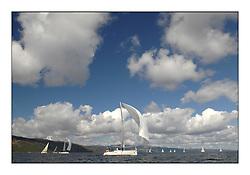 The Brewin Dolphin Scottish Series, Tarbert Loch Fyne...GBR941R  Bjaysus RUYC J124 Alan Hannon under a bright sky.
