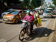 21 DECEMBER 2017 - HANOI, VIETNAM: A delivery man rides his motorbike in Hanoi.     PHOTO BY JACK KURTZ
