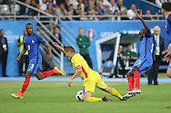 Romania Midfielder Gabriel Torje tackled by France Midfielder Ngolo Kante during the Group A Euro 2016 match between France and Romania at the Stade de France, Saint-Denis, Paris, France on 10 June 2016. Photo by Phil Duncan.