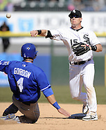 CHICAGO - APRIL 04:  Gordon Beckham #15 of the Chicago White Sox turns a double play over the sliding Alex Gordon #4 of the Kansas City Royals on April 4, 2013 at U.S. Cellular Field in Chicago, Illinois.  The Royals defeated the White Sox 3-1.  (Photo by Ron Vesely)   Subject: Gordon Beckham; Alex Gordon