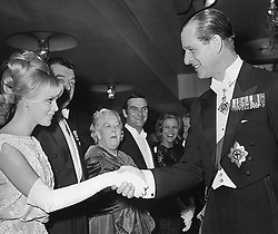 File photo dated 25/02/64 of The Duke of Edinburgh, attending the Royal Film Performance in London, shakes hands with Swedish actress Britt Ekland. The Duke of Edinburgh was linked to many glamorous women, but those close to Philip always insisted claims of affairs were untrue. Issue date: Friday April 9, 2021.