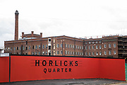 The former Horlicks factory site is pictured on 23 October 2020 in Slough, United Kingdom. The site is currently being redeveloped as Horlicks Quarter by Berkeley Homes to create five apartment blocks containing up to 1,300 new homes whilst restoring the factory building, its 47m chimney and clock tower.