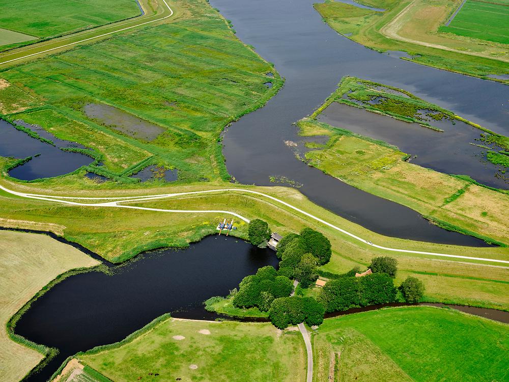 """Nederland, Overijssel, Gemeente Kampen; 21–06-2020; het Reevediep met de Noordwendigedijk en Molenkolk.<br /> Het Reevediep is aangelegd in het kader van het project Ruimte voor de Rivier om bij hoogwater water af te voeren voordat dit het nabij gelegen Kampen bereikt, direct naar het IJsselmeer, de 'bypass Kampen'. Het Reevediepgebied is ook een natuurgebied en vormt een ecologische verbindingszone tussen rivier de IJssel en Drontermeer.<br /> Reevediep, the Noordwendigedijk and scour hole<br /> The Reevediep has been constructed as part of the Room for the River project, and functions to discharge high waters before reaching the nearby Kampen, directly to the IJsselmeer, the """"bypass Kampen"""". The Reevediep area is also a nature reserve and forms an ecological connecting zone between the river IJssel and Drontermeer.<br /> <br /> luchtfoto (toeslag op standard tarieven);<br /> aerial photo (additional fee required)<br /> copyright © 2020 foto/photo Siebe Swart"""