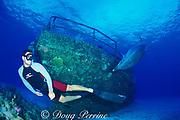 Spot, a wild, lone, sociable bottlenose dolphin, Tursiops truncatus, and pal Jason Belport on wreck of the Mariner, Cayman Brac, Cayman Islands ( Caribbean Sea ) MR 281