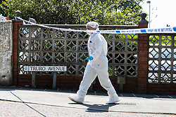 © Licensed to London News Pictures. 28/05/2018. Stockport, UK. A forensic scenes of crime examiner working at the scene outside The Salisbury Club on Truro Avenue in the Brinnington area of Stockport, Greater Manchester, where a car collided with pedestrians late last night, killing one man and injuring others.  A murder investigation has been launched. Police later recovered a black Audi A4 which fled the scene. Photo credit: Joel Goodman/LNP