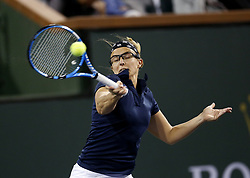 March 7, 2019 - Los Angeles, California, U.S - Eugenie Bouchard of Canada, returns the ball to Kristen Flipkens of Belgium during the women singles first round match of the BNP Paribas Open tennis tournament on Thursday, March 7, 2019 in Indian Wells, California. (Credit Image: © Ringo Chiu/ZUMA Wire)