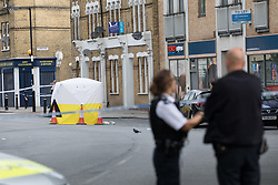 June 3, 2017 - London, London, UK - LONDON, UK.  Police officers and a police car at the crime scene cordon in Peckham, near Camberwell in south east London this morning.  A teenage boy, 17 was stabbed to death in Southampton Way near the Tesco Express store. (Credit Image: © Vickie Flores/London News Pictures via ZUMA Wire)