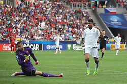 Italy's Andrea Petagna (right) has a shot saved by Czech Republic goalkeeper Lujas Zima